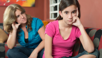 Teenage problems - Teenage girl with her sad and worried mother