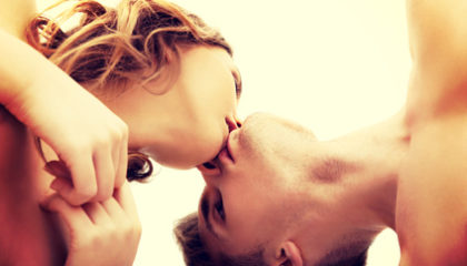 Young beautiful caucasian couple kissing.